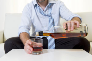 Image of businessman needing alcohol use assessment