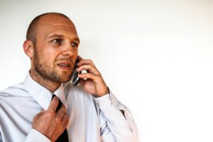 Image of businessman calling counsellors on phone
