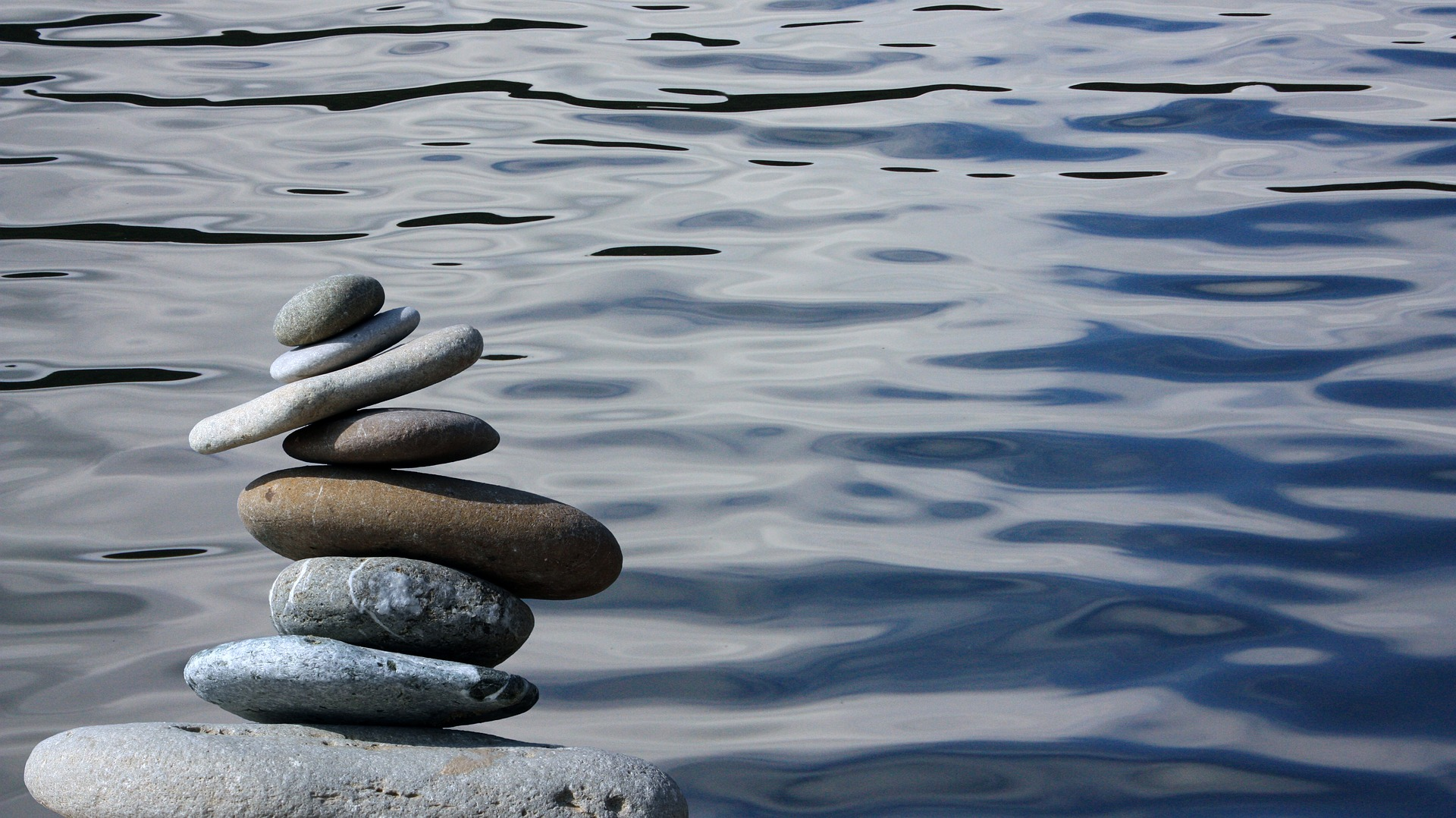 Image of stones balancing to indicate managing anxiety